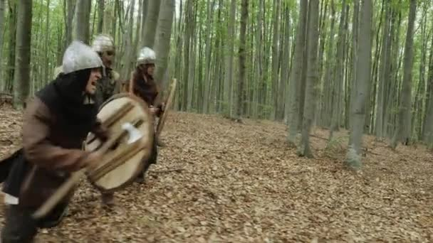 Warriors of Vikings are Fighting during Attack. Vikings hitting the shields.