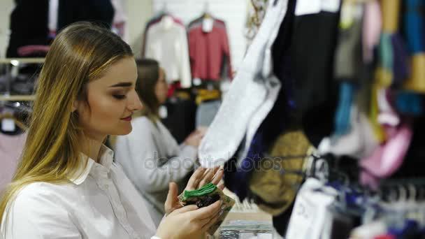 Close-up of woman choosing socks in the store