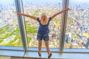 Osaka skyline woman