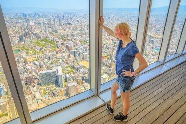Osaka skyline woman looking