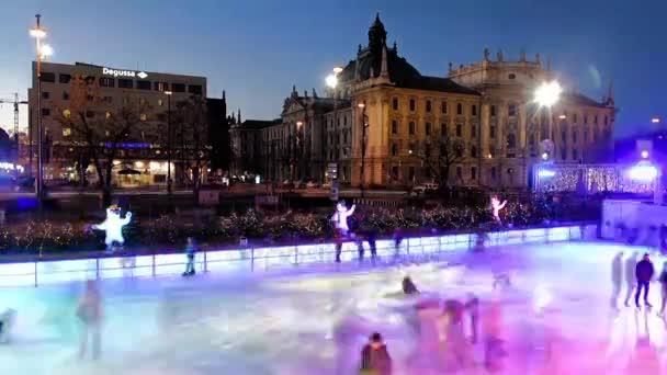 Timelapse of people iceskating on the ice rink at Karlsplatz/Stachus, Munich, Germany