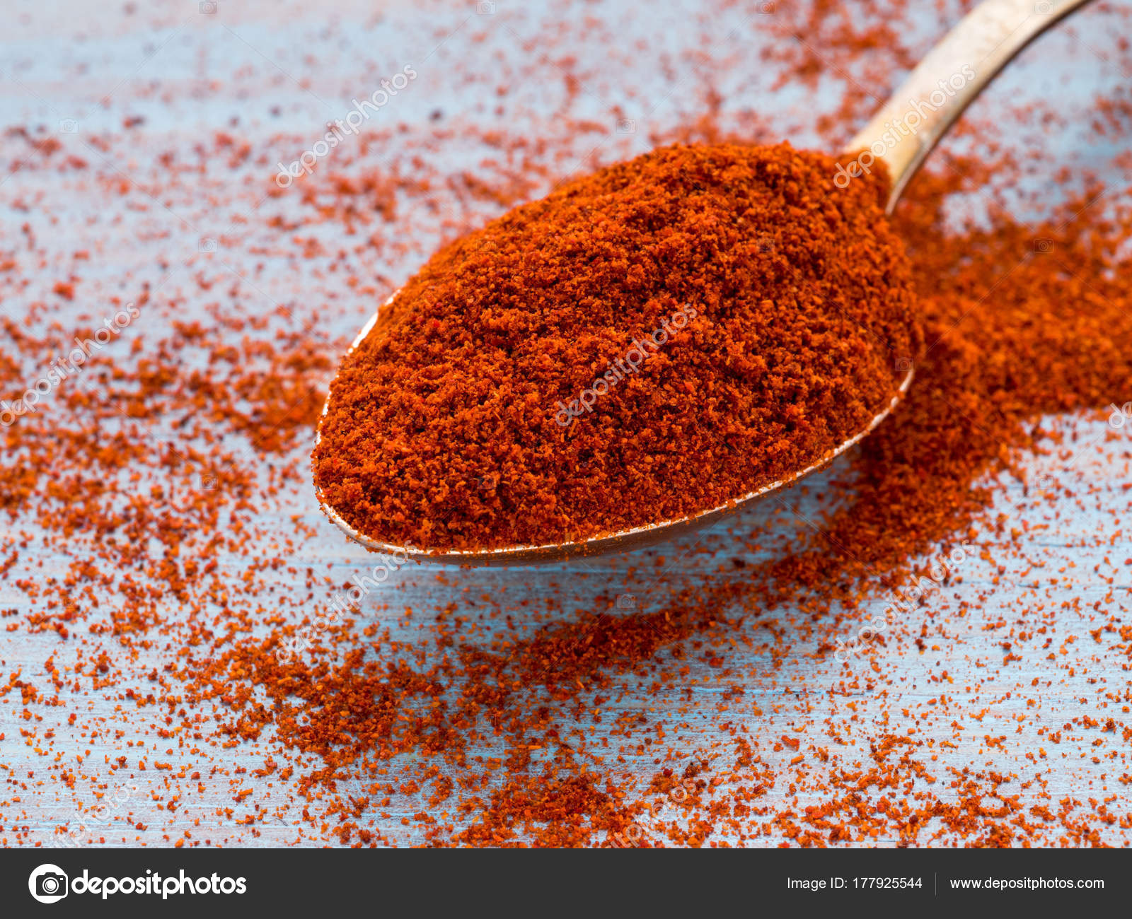 one heaping scoop of spices of paprika powder scattered on the