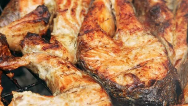 Fried grilled salmon on bbq. Marinade from white sauce and lemon.
