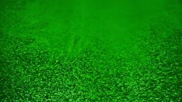 A festék beleesik a vízbe, ami csavar. Spin akril tinta csöpög a folyadék. Vizuális effektus golyóidő, lefagyott pillanat. A színes felhő permetcsepp..