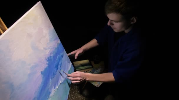 Artist copyist paint seascape with ship in ocean. Craftsman decorator draw as boat sail on blue sea with acrylic oil color.