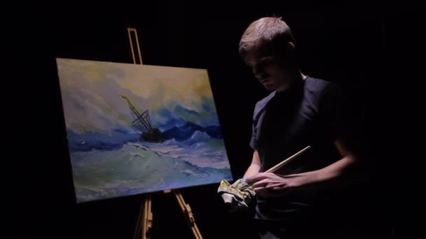 Artist copyist paint seascape with ship in ocean. Craftsman decorator draw as boat sail on blue sea with acrylic oil color. Draw brush, knife palette.