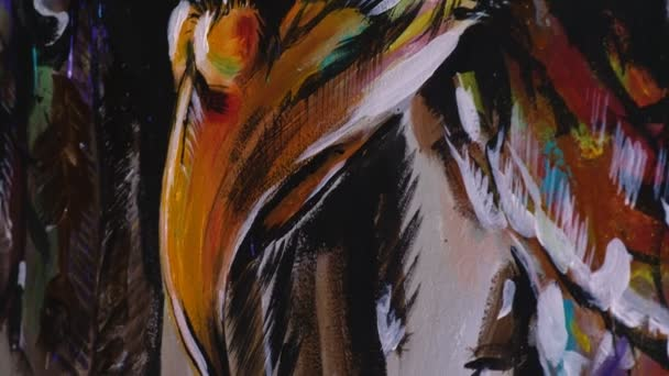 Artist designer draws an eagle on the wall. Craftsman decorator paints a picture with acrylic oil color. Close-up dark magic cinematic look.