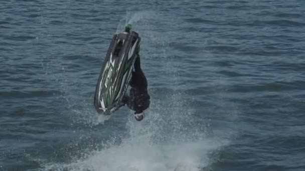 Irkutsk, Russia - August 3 2019: Baikal Jet Fest, BJF. Freestyle jet ski tricks backflip, barrel roll, 360, superman, submarine. Jet ski slow motion.
