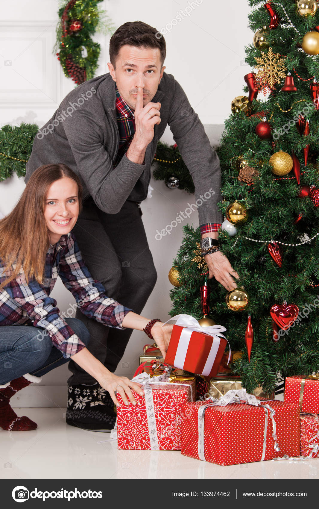Parents put christmas gifts — Stock Photo © ALotOfPeople #133974462