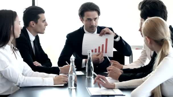 Businessman showing diagram