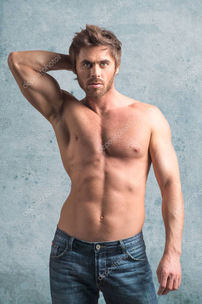 Muscular Young Naked Boy Posing In Jeans Stock Photo