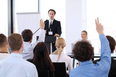 Speakers at business meeting