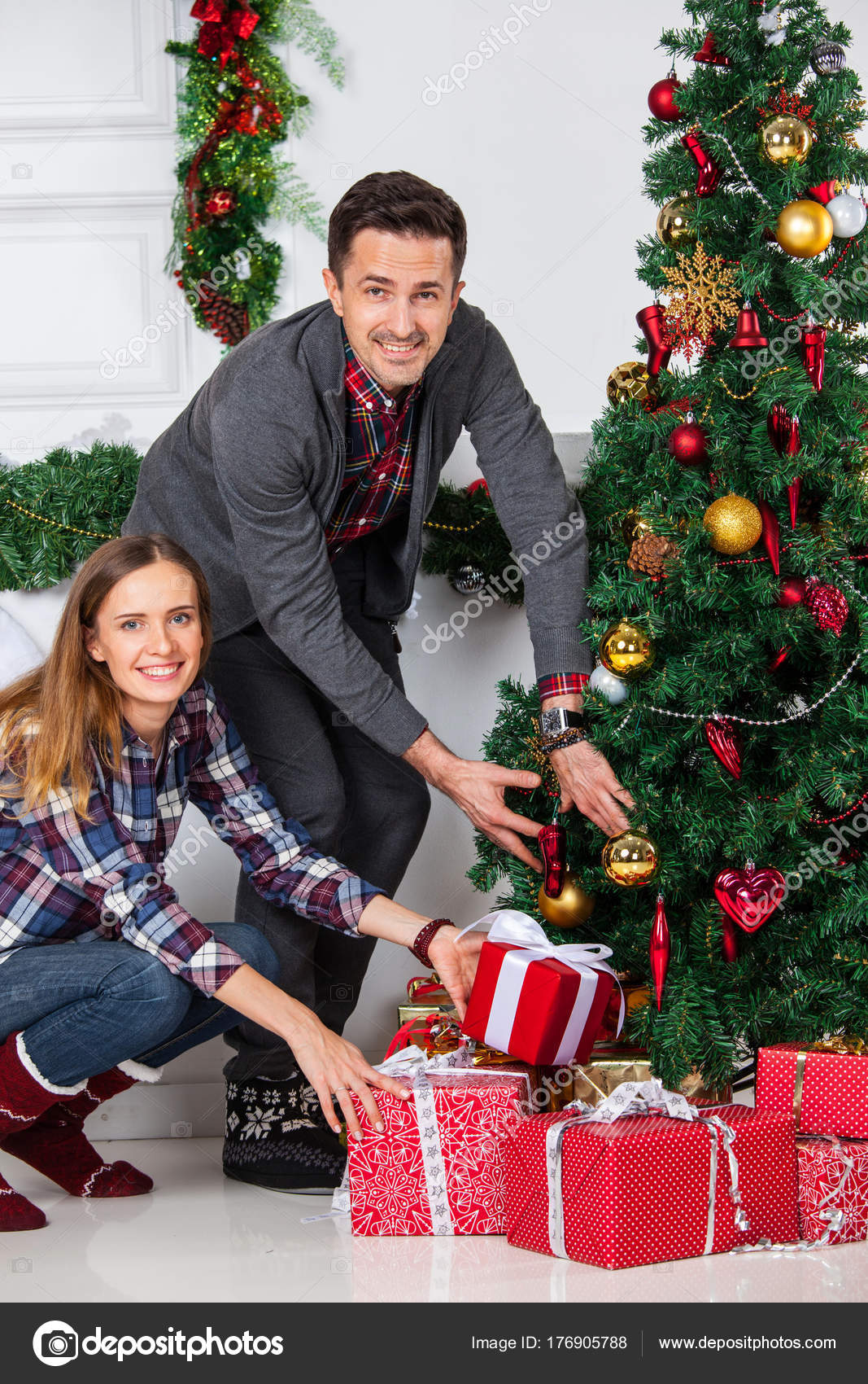 Couple with Christmas gifts — Stock Photo © ALotOfPeople #176905788