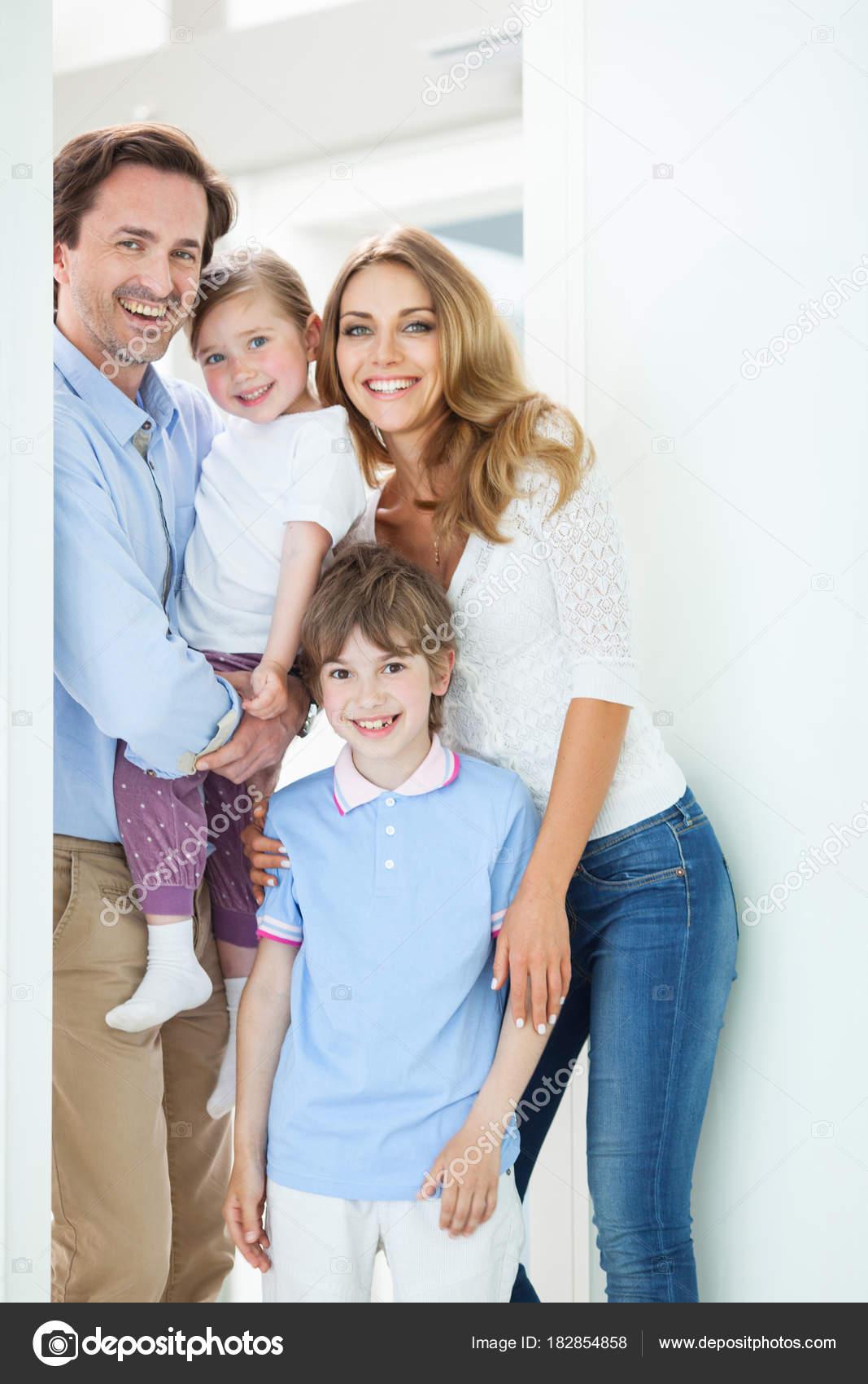 Happy family in doorway — Stock Photo