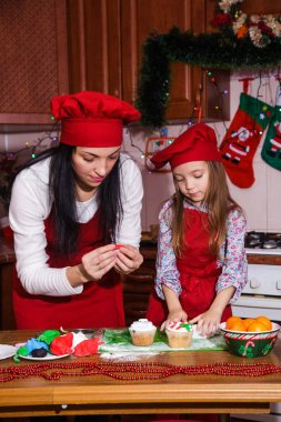 Christmas party dinner menu dessert idea chocolate peppermint cupcakes cheese cream sugar sprinkling decoration mother daughter new year red apron chef chief confectioner