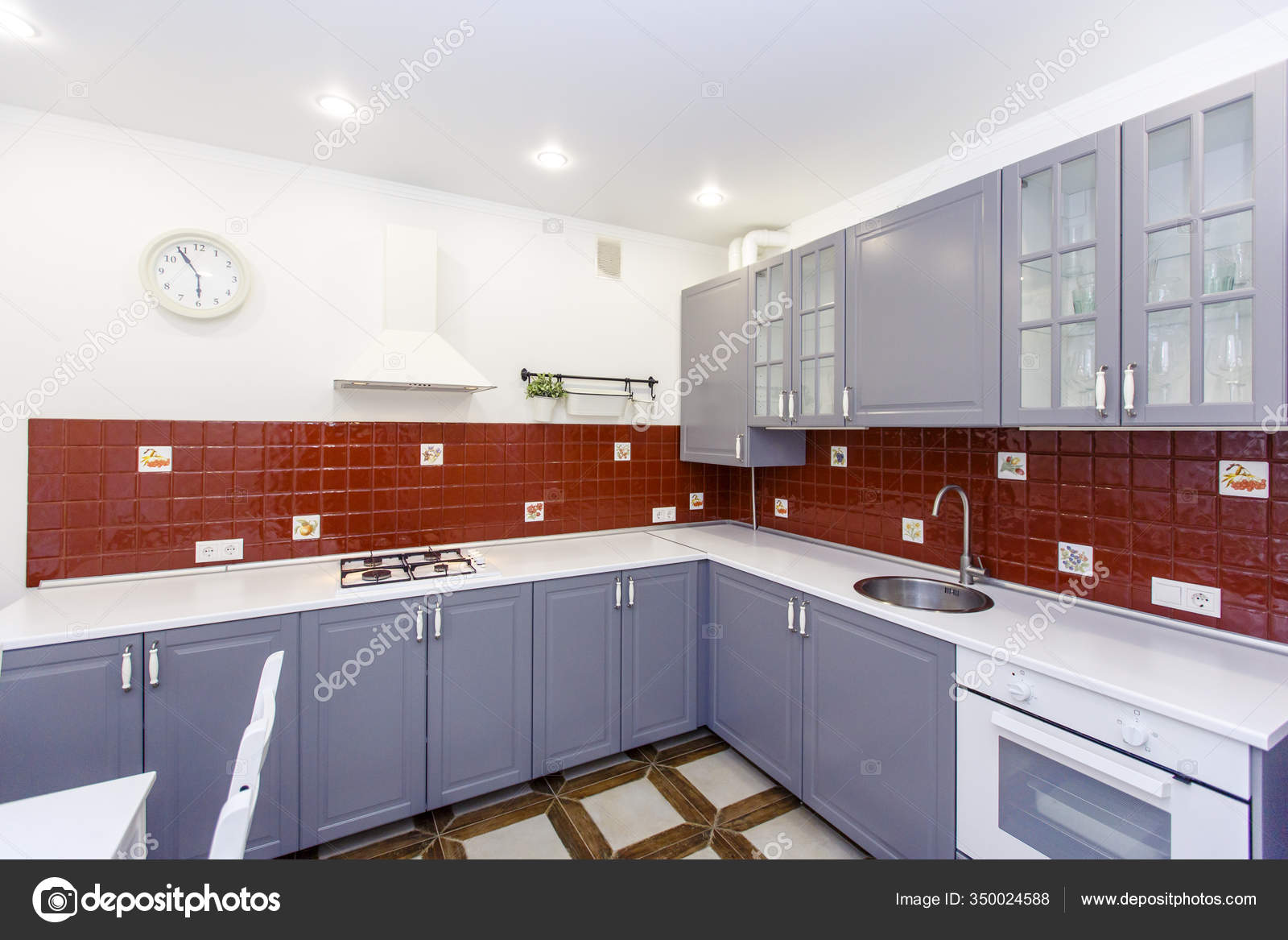 Modern Stylish Large Kitchen In The Cottage Kitchen In Red And Steel Colors The Doors Are Steel Colored And The Tiles On The Wall Are Red The Floor Tiles Are Beige White Table