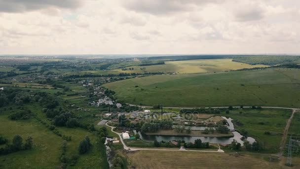 Aerial small rural country side. Flight over rural country homes