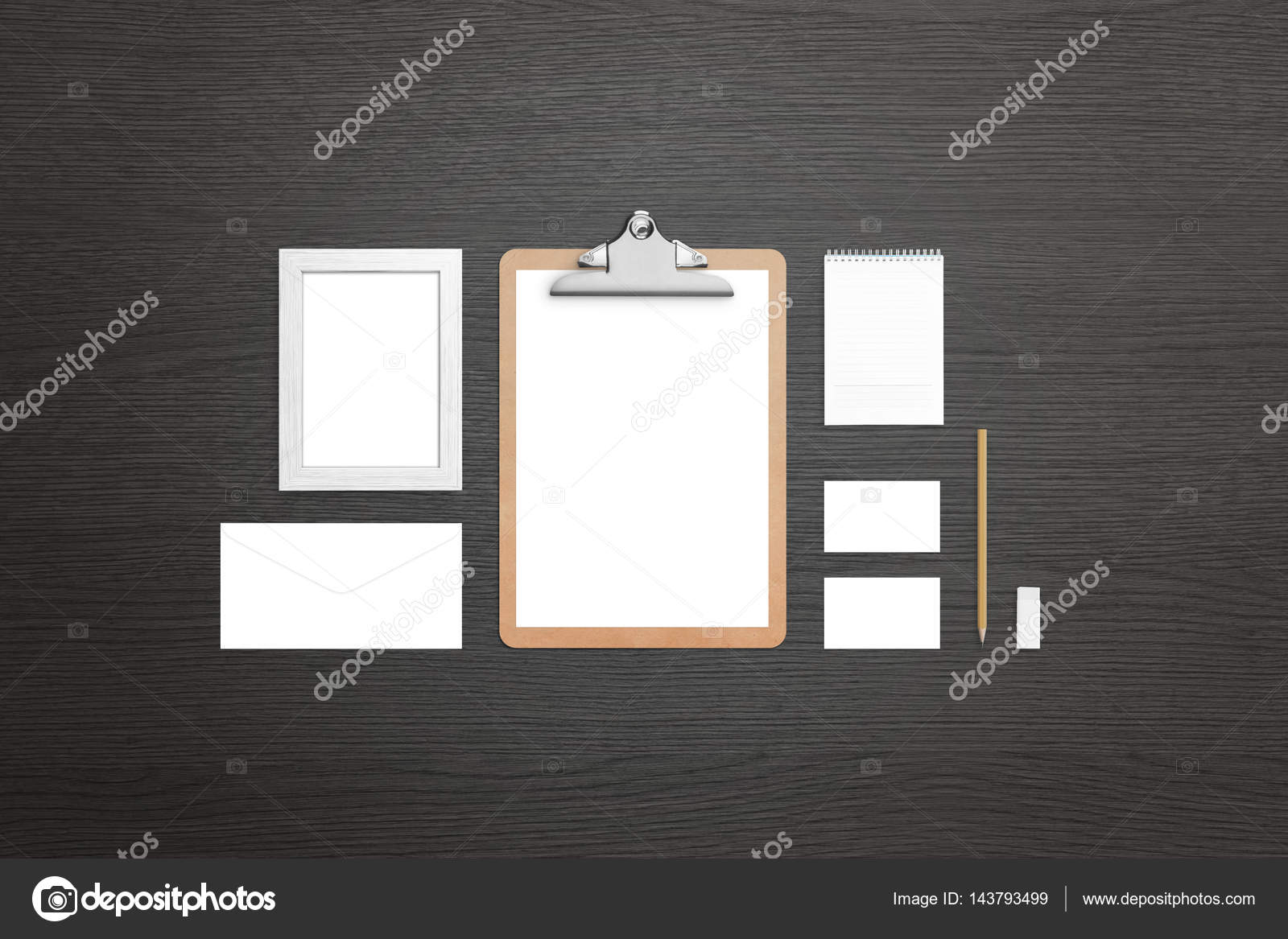 Clean stationery on black wooden table. Top view of isolated items ...