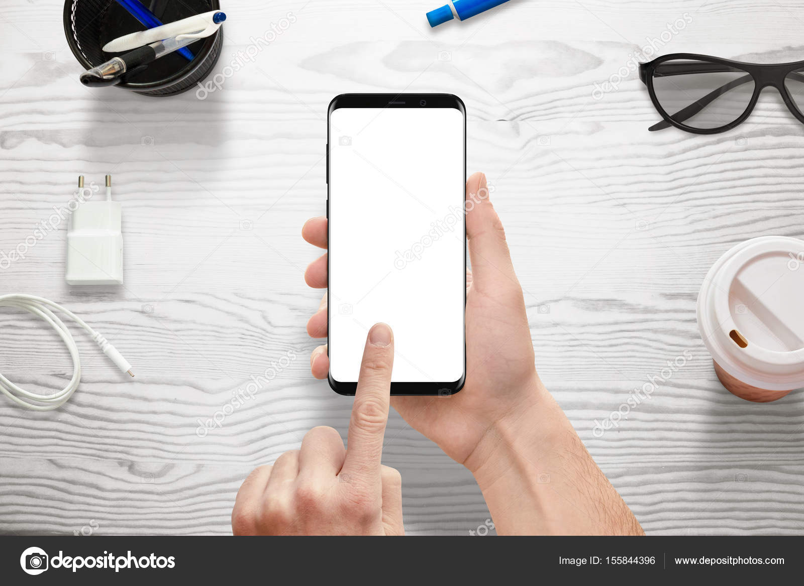 hand holding modern smart phone with isolated white screen for