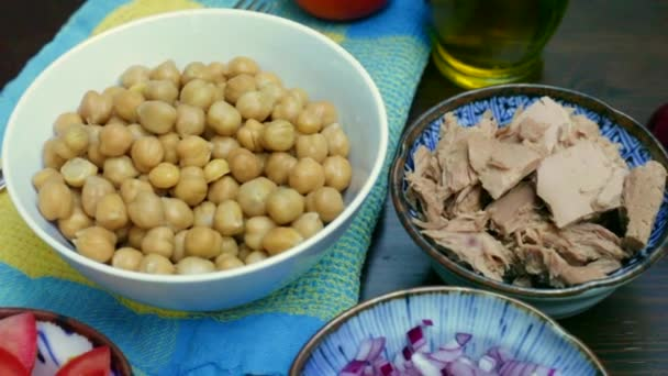 chickpeas with tuna salad ingredients prepared in bowls