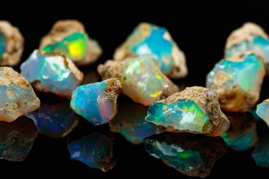 macro mineral stone rare and beautiful opals on a black backgrou
