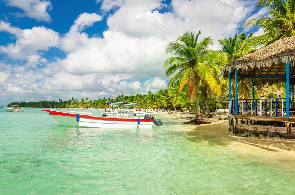 Amazing Caribbean coast with moored motorboat, Dominican Republic