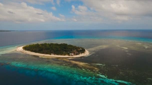 Aerial view beautiful beach on tropical island. Mantigue island Philippines.