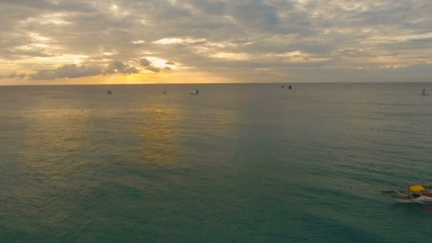 Beautiful sunset over sea, aerial view. Boracay island Philippines.