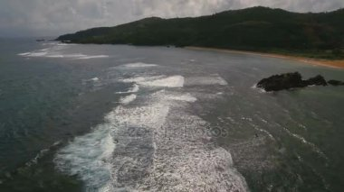 Aerial view surfers on the waves.Catanduanes, Philippines.