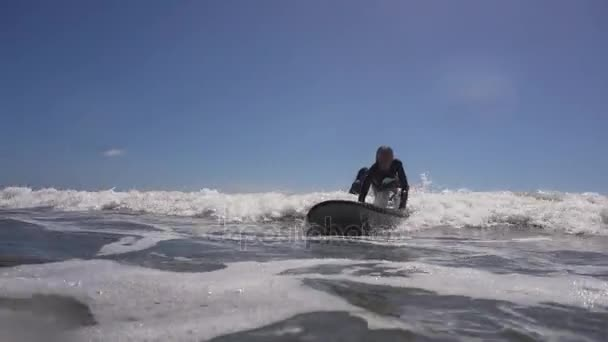 Girl surfing in the ocean.