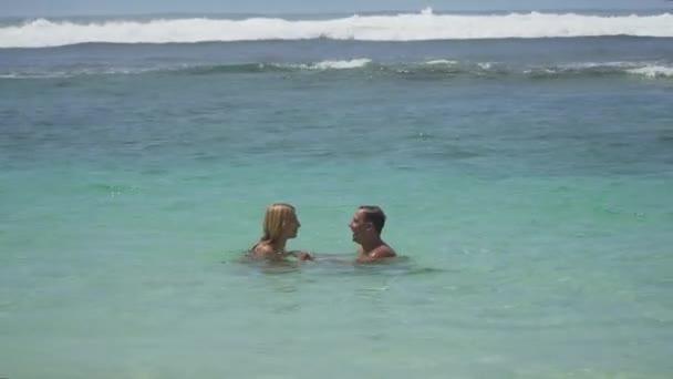 Happy couple on the sea.