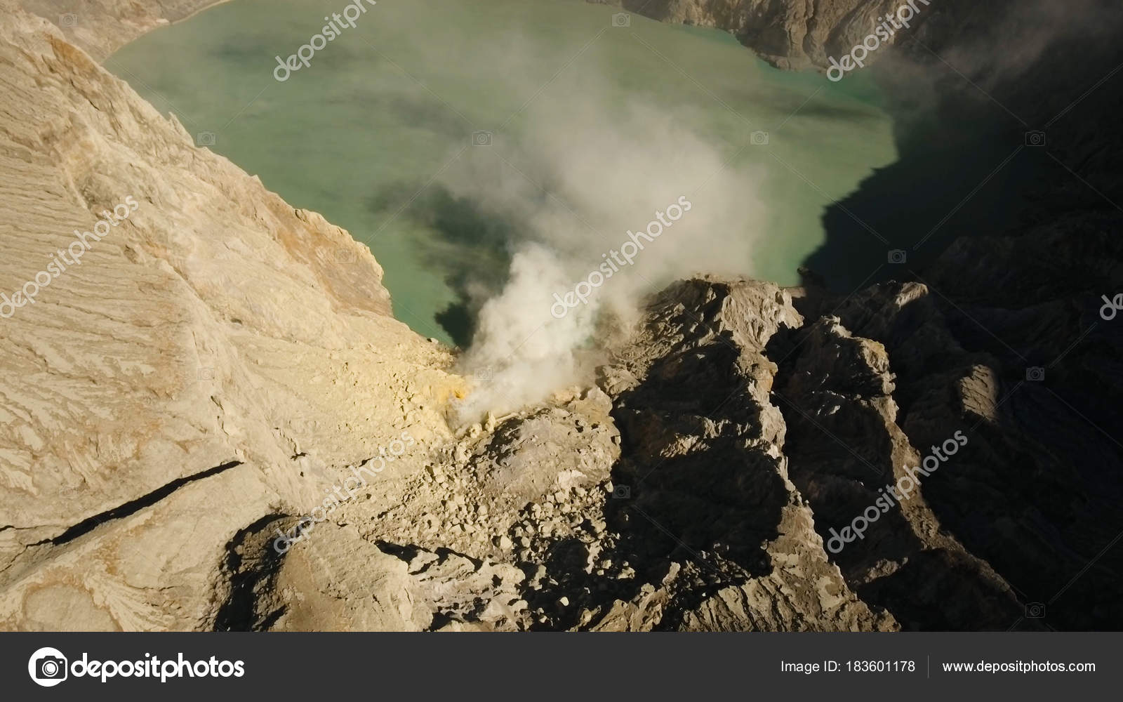 volcanic crater where sulfur is mined stock photo alexpunker