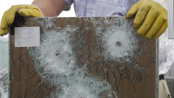 Three Round Cracks and a Lot of Fractures From Bullets Used to Test the Multilayer Bulletproof Glass in Some Laboratoryin Kiev