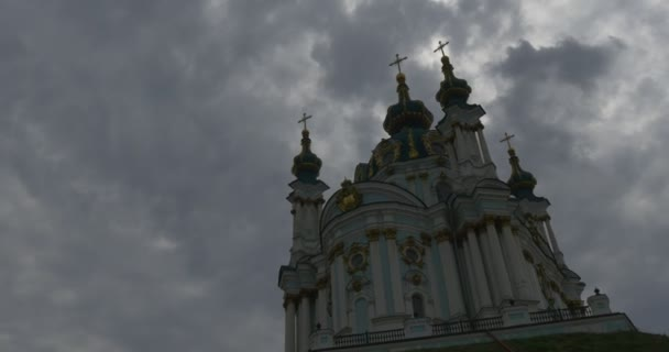 Impressive Golden Domes of the Saint Andrews Church Overlooking the Historic Podil Neighborhood in a Grey Weather in Summer