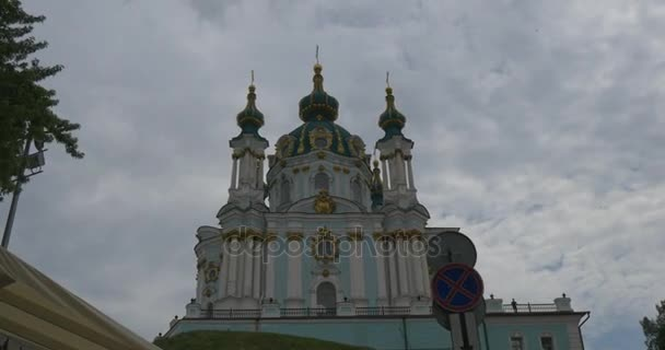 Impressive View on the Beautiful Fretwork, Moldimg, Columds and Golden Domes of the Saint Andrews Church Located on Andriyivsky Descent in Cloudy Weather