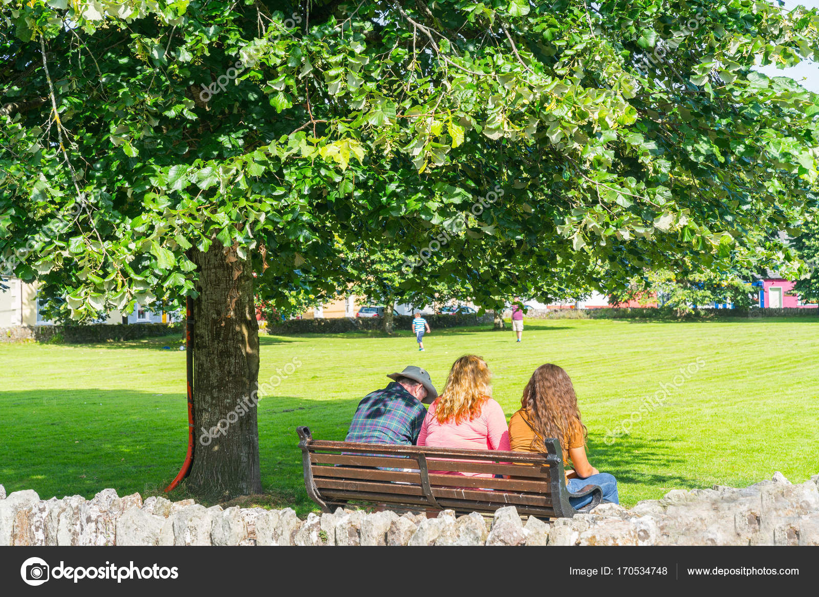 Three People Sitting Park Bench Back View Stock Editorial Photo