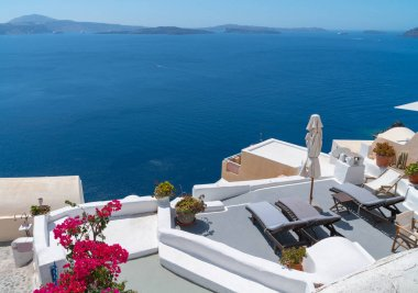 Hillside homes and buildings in whitewashed traditional Greek Is