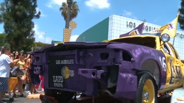 LAPD Lakers Car. And old cop car painted in the yellow, purple, and gold colors outside of Staples Center following the 2010 LA Lakers Championship parade on June 21st, 2010, Los Angeles, California.