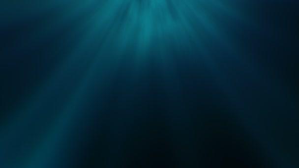 Hluboko pod vodou světelné paprsky. Abstraktní světelné paprsky slunce prostřednictvím soft modro zelené pozadí s slavnostní a osamělý pocit, že hluboko pod vodou.