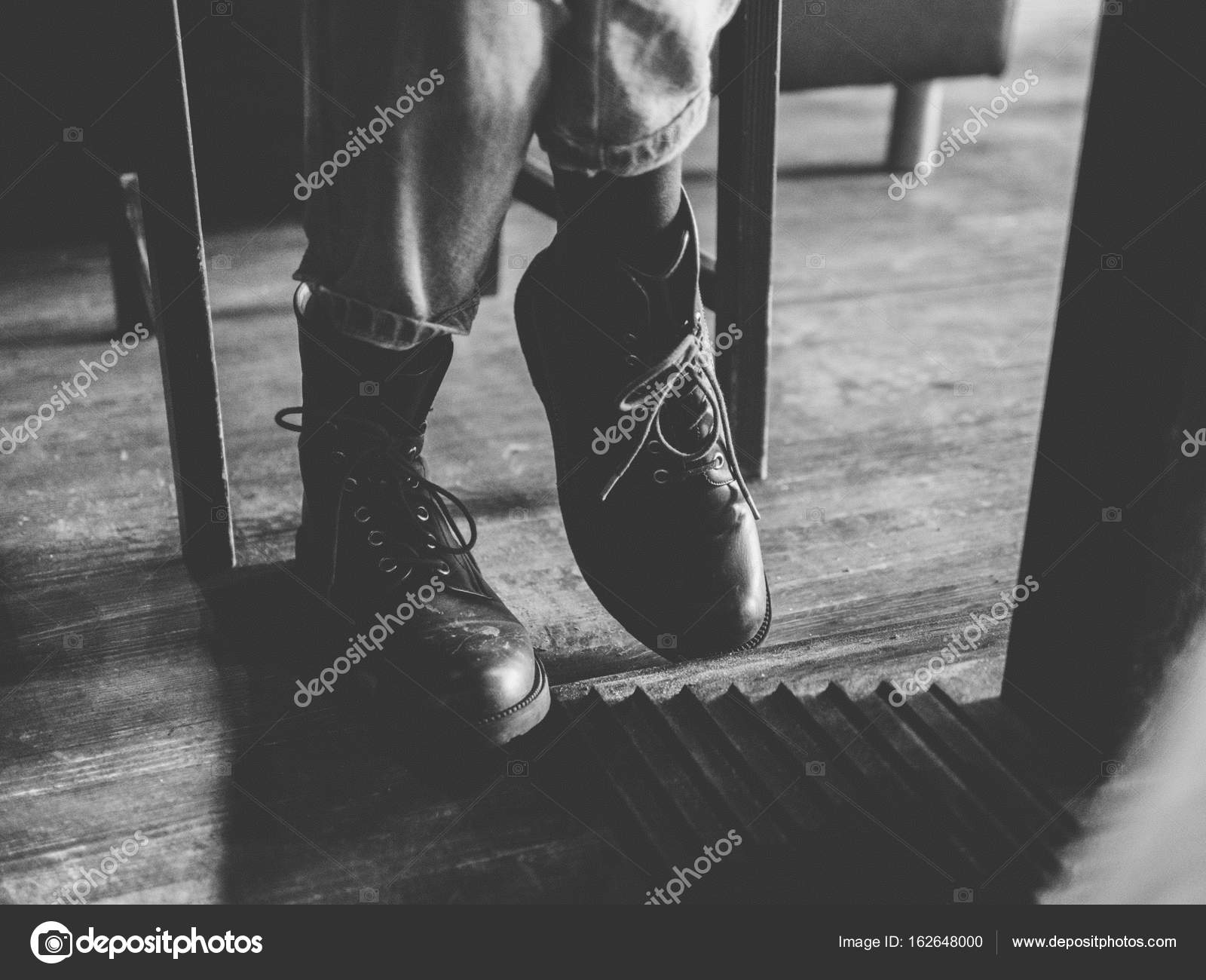 Legs shoes under table wood floor Stock Photo paulzhuk 162648000