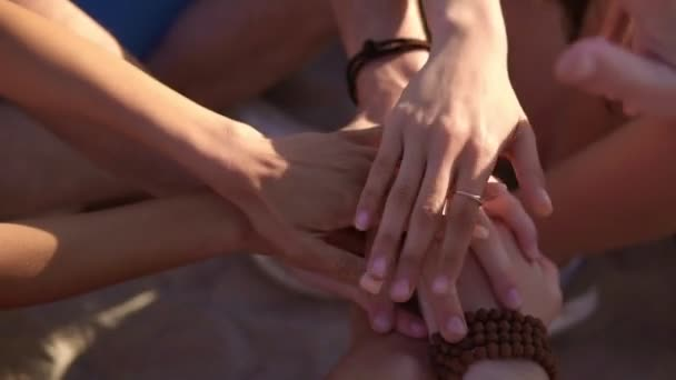 Closeup view of many hands together united in support. Teamwork and friendship concept. Slowmotion shot