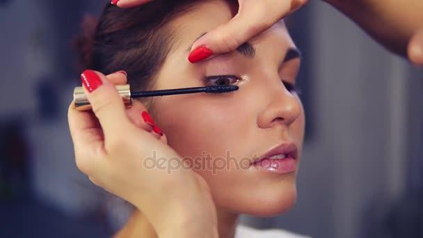 Professional Makeup Artist Applying Mascara On The Models Eye Work