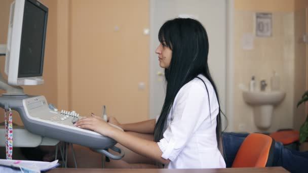 Echocardiography and ultrasonography in the doctors office: female doctor examining a patients heart by using an ultrasound equipment. Doctor scanning heart of caucasian male patient. at hospital