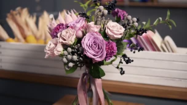 Side view of beautiful fresh bouquet in the flower shop: floral composition consists of Rose, Brunia, Protea with beautiful ribbon