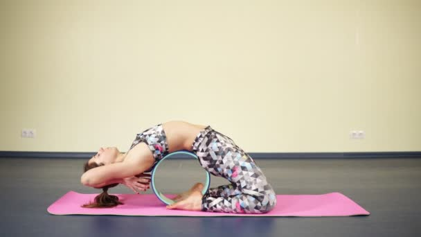 Woman In Attractive Sports Wear Stretching Core And Back While Practising Yoga Asanas Stock