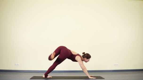 Young Attractive Woman Practising Yoga Asanas To Stay Fit And Healthy Downward Dog
