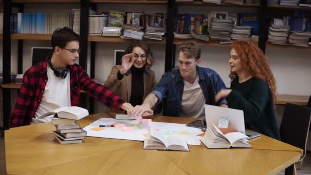 European happy team of business people or students stack hands in pile together as teamwork and help, friendship concept, support in group work, unity trust cooperation. Front footage. Slow motion
