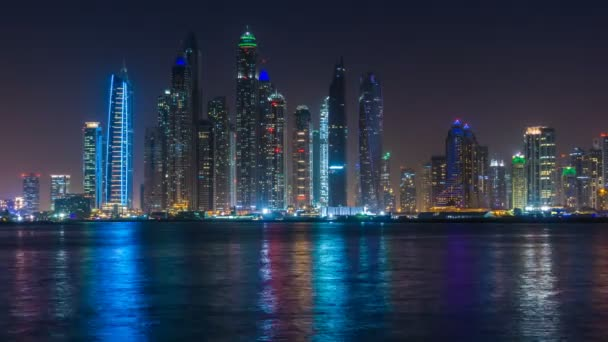 Dubai Marina night light illumination Palm Jumeirah bay panorama 4k time lapse UAE
