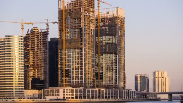 Sunset time Timelapse Business Bay, central business district under construction in Dubai, UAE
