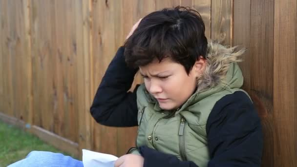 Young boy wipes his nose with a tissue  Winter concept